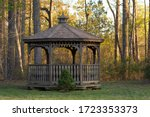 A Wooden Gazebo With A Small...