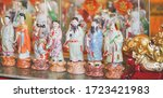 Chinese Pottery Doll. A Roll O...