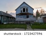 Small photo of Chicago Heights Illinois, US – May 1st 2020: Condemn Abandoned House | front porch collapsed | house completed gated to protect the public from entering the property.