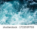 Abstract blue sea water with white wave for background - stock photo
