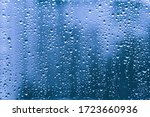 Rain Drops On A Blue Window...