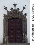 An Ornately Carved Door And...