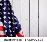 Small photo of American Flag for the America's 4th of July Celebration over a white wooden rustic background to mark America's Independence Day