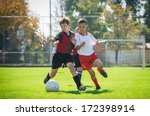 boys  kicking football on the... | Shutterstock . vector #172398914
