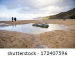 Stock photo watergate bay dog walkers 172407596