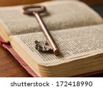 an old key on top of an old... | Shutterstock . vector #172418990