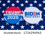 Small photo of London, UK - May 5th 2020: Donald Trump and Joe Biden pin badges, pictured of the USA flag. The two men will be battling eachother in the 2020 US Presidential Election.