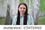girl walks in a birch grove on...   Shutterstock . vector #1724723410