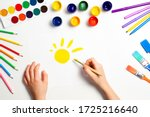 Kid Hands Painting Yellow Sun....