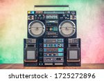 Small photo of Retro boombox ghetto blaster outdated portable radio receivers with cassette recorder from 80s front gradient colored wall background. Rap, Hip Hop, R&B music concept. Vintage old style filtered photo