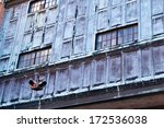 Abandoned World War II factory - grunge, retro, vintage siding with old-style stoplight  - stock photo