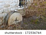 Millstone at an old pre-World War II flour mill in Martinsburg, WV - stock photo