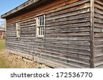 Old schoolhouse in Martinsburg, WV - aged wooden siding and windows - stock photo