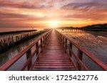 A Long Red Wooden Bridge ...
