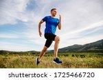 Sporty man runner running on...