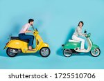 Small photo of Yeah I first. Full body profile side photo positive funky bikers woman drive fast chopper look back enjoy she overtake man wear white pink shirt pants trousers isolated blue color background