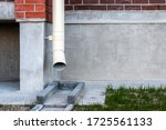 Drain Pipe On The Brown Brick...