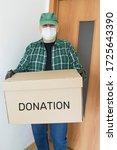 man at green shirt holding box... | Shutterstock . vector #1725643390