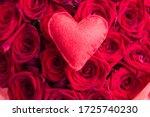 Red Felt Heart Against Red...