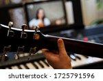 Virtual guitar lesson. female...