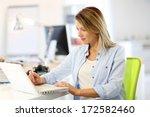 smiling businesswoman working... | Shutterstock . vector #172582460