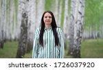 girl walks in a birch grove on...   Shutterstock . vector #1726037920