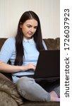 woman working on laptop...   Shutterstock . vector #1726037923