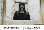 Guy In The Gas Mask And Black...