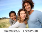 happy family with little boy in ... | Shutterstock . vector #172639058