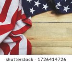 Close up american flag on wood...