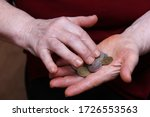The Pensioner's Hands Count...