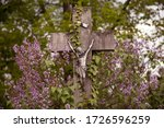 Stone Cross With Jesus In The...