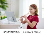 Child playing flute. remote...