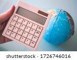 Hand Holding A White Calculato...