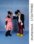 Small photo of Animator for children in a Mickey mouse costume and a Mini mouse girl in the Studio in costume, Moscow, June 10, 2014. Animator for a holiday for children