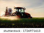 Tractor Spraying Pesticides...