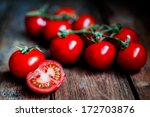 tomatoes on the vine on rustic... | Shutterstock . vector #172703876