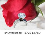 Diamond Ring And Red Rose On...