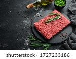raw minced meat on a black...