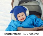 cute smiling baby sitting in a... | Shutterstock . vector #172736390