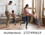 Happy Parents Dancing With...