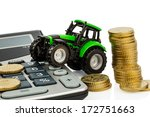 Small photo of farmers in agriculture have to reckon with rising costs. higher prices for feed, fertilizer and plants. tractor with coins and calculator