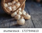White Mushrooms And Basket On...