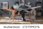 Fitness woman practising yoga...