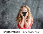 The girl wears a hygiene mask to prevent coronavirus. Masked people. An outbreak of a new corona virus (CoVid-19). air pollution, environmental awareness concept. Russia, Moscow, May 2020 - stock photo