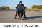 Front View Of Young Biker In...
