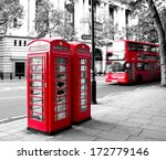 Red Phone Booth And Red Bus In...