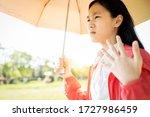 Child Girl Is Holding Umbrella...