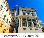 Genoa, Liguria, Italy - September 11, 2019: Facades of old Italian buildings in old part of town, windows with shutters, old building in Genoa, Italy. - stock photo