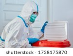 Small photo of Surgeon in protective clothing in clinic before heart transplant with organ donation after transport in a box